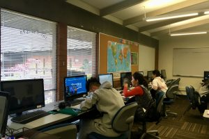Students sitting at computers and working on their homework in the ESL Study Center